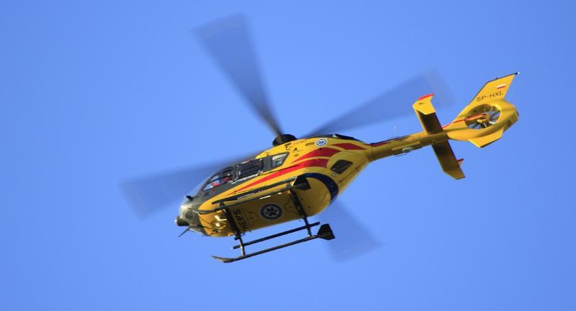 Pożary interwencje straży , Kobieta zasłabła cmentarzu Dobrzyniu Wisłą ratunek przyleciał helikopter - zdjęcie, fotografia